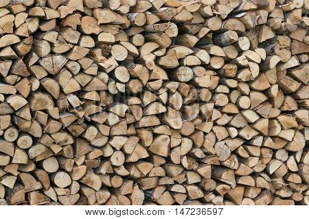 stacked firewood wall at the house in the garden