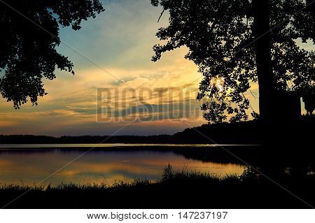 Beautiful panoramic view of the sunset over Lemiet lake in Mazury lake district, Poland. Lake landscape at sunset, fantastic travel destination. Masuria Polish: About this sound Mazury, German: Masuren is a region in northern Poland famous for its 2, 000