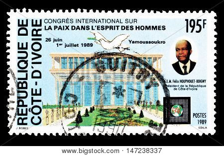 IVORY COAST - CIRCA 1989 : Cancelled postage stamp printed by Ivory Coast, that shows president Houphouet Boigny.