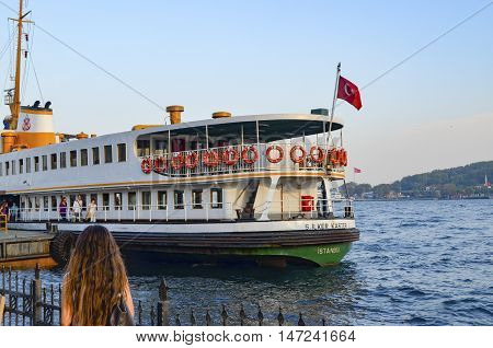 Istanbul Turkey - October 2 2012: Ferry in Karakoy pier. Istanbul Ferries continue to serve as a key public transport link for many Thousands of commuters tourists and vehicles per day.