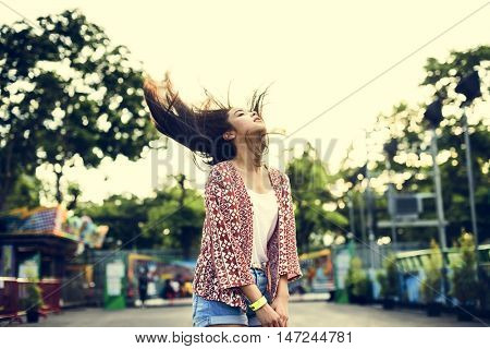 Young Girl Hair Fling Funfair Festive Playful Happiness Concept