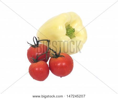 Ripe fresh organic tomatoes wit drops of water and yellow gypsy pepper separated on white background