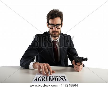 Boss forces you to sign an agreement by threatening with the gun