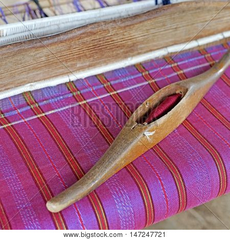 Wooden Bobbin On Ancient Silk Loom