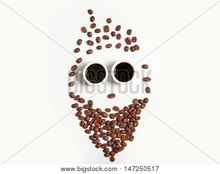 Smiley Of Coffee Beans In Cups Isolated On White