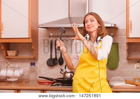 Dancing Housewife In Kitchen