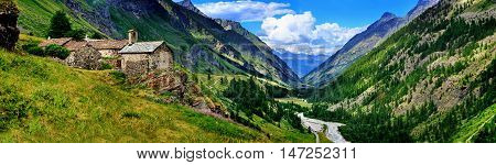 Old alps architecture with mountains panoramic view in Rhemes Notre Dame, Valle d'Aosta, Italy