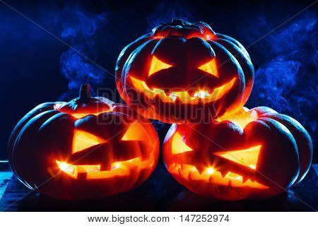 Halloween pumpkin head jack lantern with scary evil faces spooky holiday