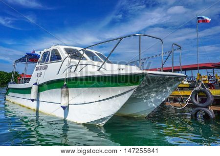 Semporna,Sabah-Sept 10,2016:Sabah Park catamaran patrol boat moored in the clear turquoise water on a sunny day on 10th Sept 2016 at Semporna,Sabah,Borneo.