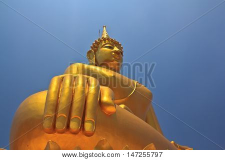 Big Buddha image on blue sky background in Thailand