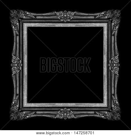antique black picture frame isolated on black background