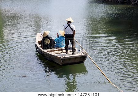 KAGAWA, JAPAN - JULY 20 2016: The small tourist ship of the pond of Tamamo Park Garden in Takamatu, Kagawa, Japan on July 20, 2016. Tourists are enjoying sightseeing.