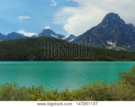 Canadian Landscape with Turquoise Lake and Rocky Mountains
