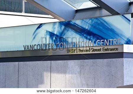 Vancouver, BC - April 20, 2015 - Vancouver Convention Center corner piece sign at the West Burrard street entrance, beautiful blues and tones