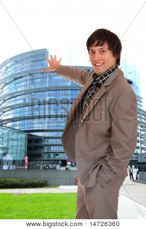 Deputy standing in front of the  European Parliament in Strasbourg