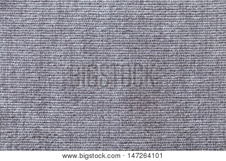 Light gray background from a soft textile material. sheathing fabric with natural texture. Cloth backdrop.