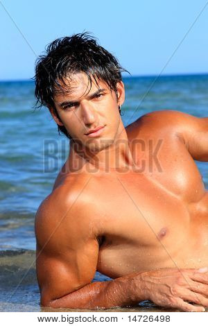 Handsome young man on beach.