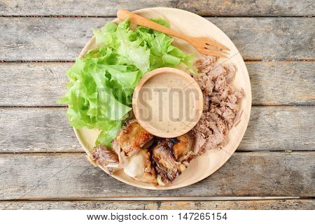 Clean food diet : chicken green oak lettuce and canned Tuna with sauce sesame seeds