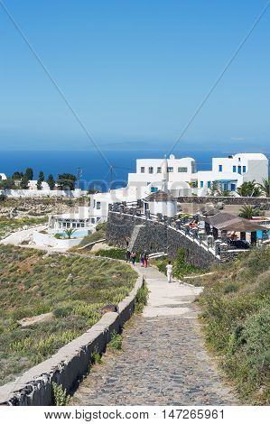 Traditional style street to the Oia near houses of Santorini Greece