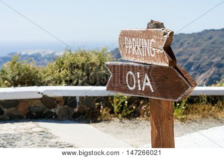 Path from Thira to Oia Santorini island Greece. Wooden path sign.