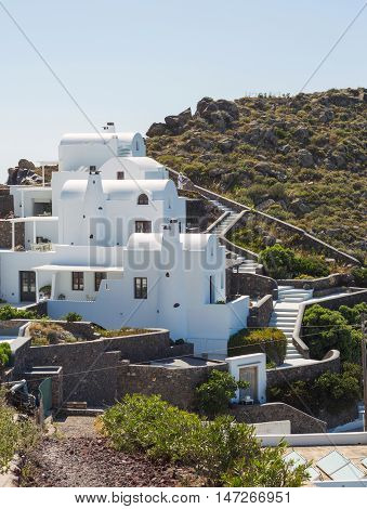 Luxury hotel in mountains with sea view. White architecture on Santorini island Greece. Beautiful summer landscape