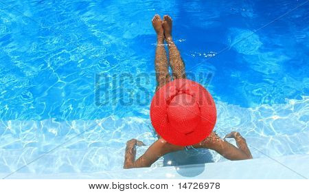 Young woman enjoying a swimming pool