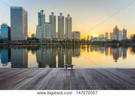 Bangkok city downtown at sunrise with reflection in BangkokThailand