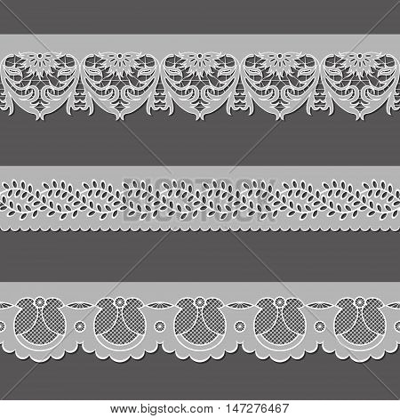 set of ribbons embroidered cutwork on a gray background