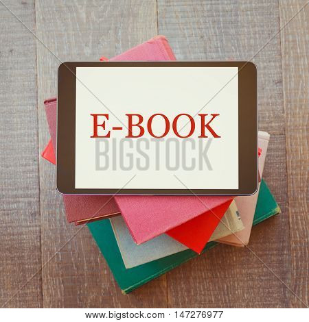 E-book library concept with digital tablet and books