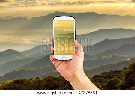 Smartphone photographing close up layer of mountains and mist in sunrise time Landscape at Doi Luang Chiang Dao High mountain in Chiang Mai Province Thailand