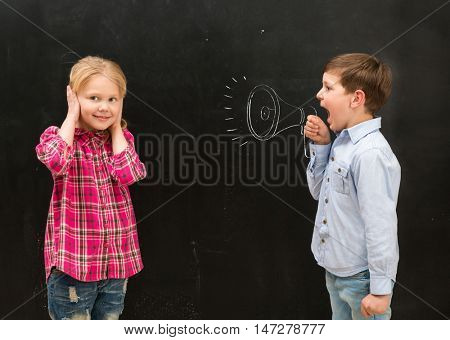 little boy shouting in drawn on the blackboard mouthpiece and little girl covering her ears with her hands