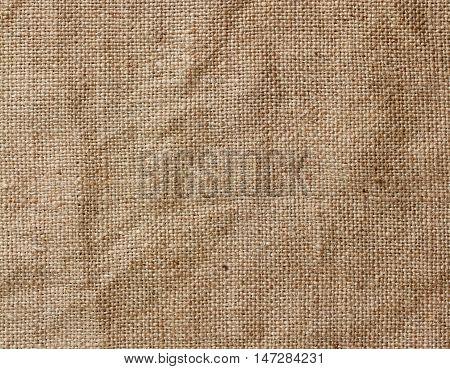 Rough texture of burlap textile background closeup. Sackcloth canvas.