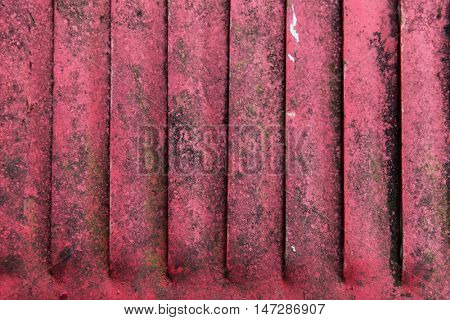 texture and background concept - close up of old red rusty metal flaps