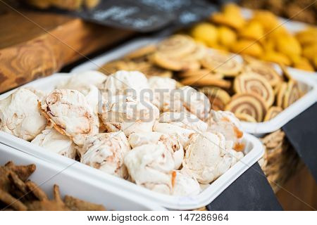 food, junk-food and sweets concept - close up of meringue cookies on serving tray