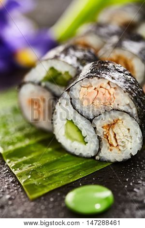 Maki Sushi - Roll made of Salmon, Smoked Eel and Cucumber inside. Nori Outside