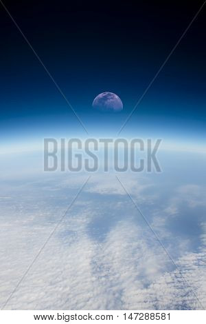 The half moon in a high altitude space background