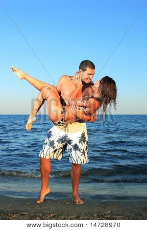 An attractive Young Couple enjoying a Romantic Getaway on the beach