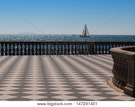 Livorno' s Mascagni Terrace and White Sailing Boat in Background Tuscany - Italy