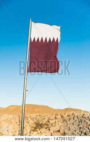 Waving National flag of Qatar on flagpole