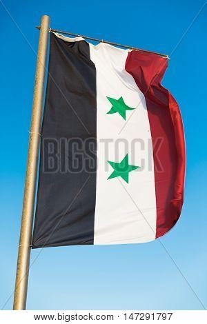 Waving National flag of Syria on flagpole