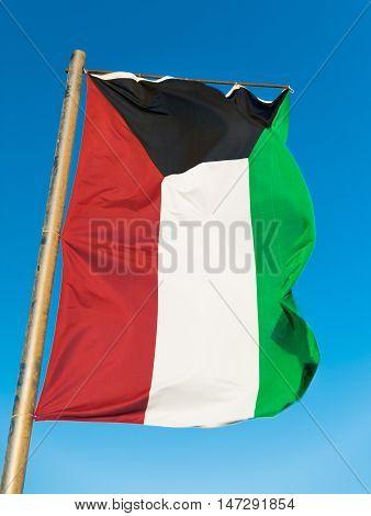 Waving National flag of Kuwait on flagpole