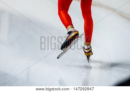 feet of a woman skater in red tights and racing skates