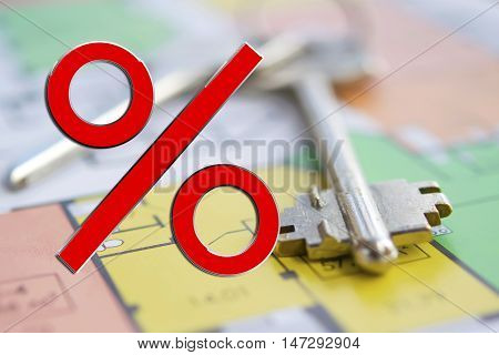 Red percent sign on the background of the keys to the house . The concept of reducing property prices