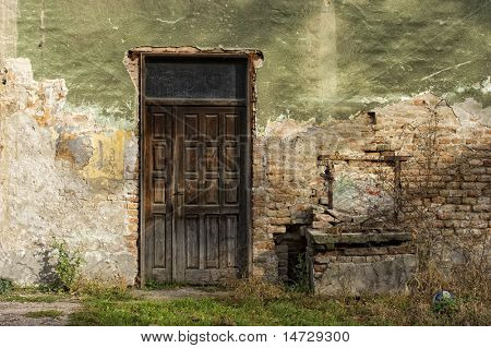 old door and window of brick building