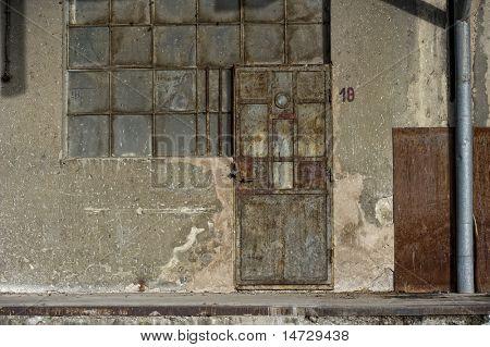 old door and window of brick building