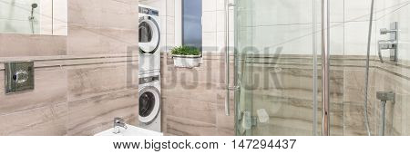Elegant Bathroom With Laundry Area