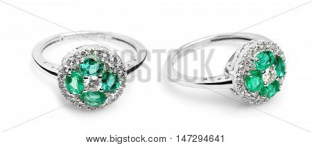 Close up of a beautiful Sapphire Diamond ring having many diamonds and emerald. Isolated on white background.