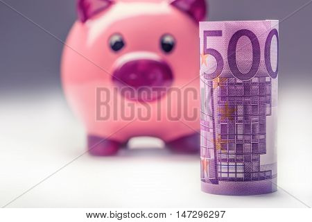 Piggy bank.Pink Piggy save and Five hundred Euro banknotes.Toned photo.