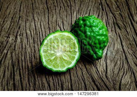 Close up bergamot on wooden table background (Kaffir lime)