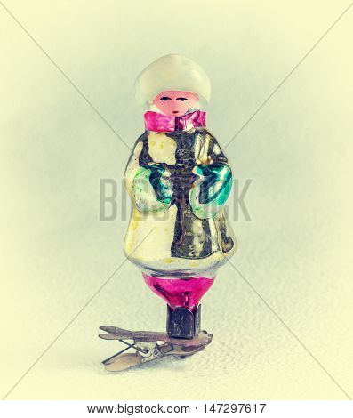 Old-fashioned Christmas tree decoration: snow maiden toy piece of glass